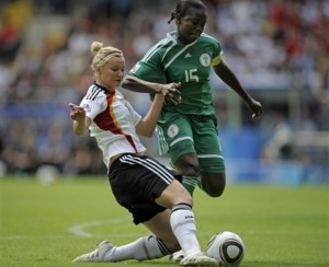 Germany's Alexandra Popp, left, scores the opening goal past Nigeria's Joy Jegede, right